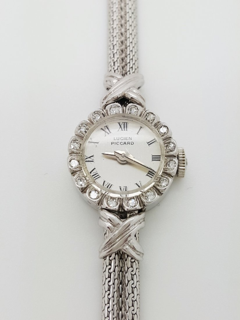 A vintage Lucien Piccard 14k ladies diamond wrist watch
