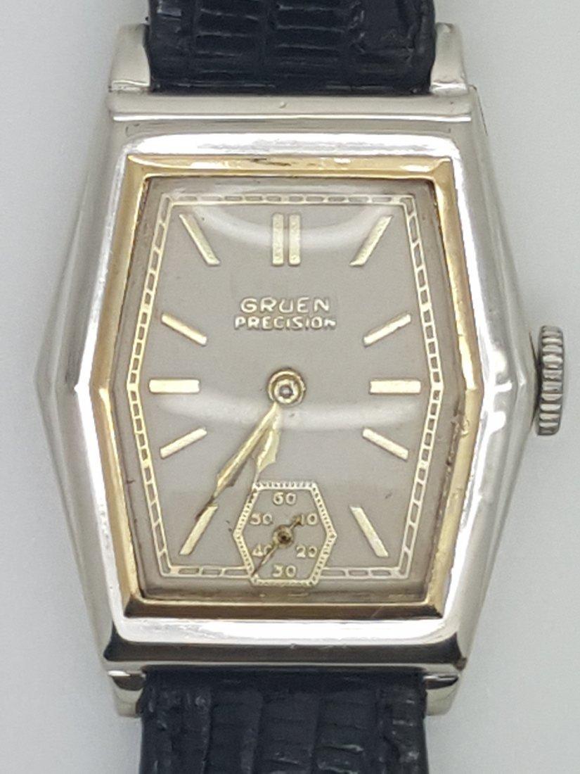 A vintage Gruen Precision gold filled manual wrist