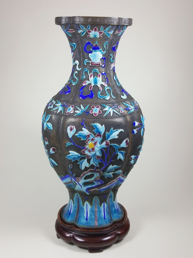 A Qing dynasty vase hand enameled on bronze with