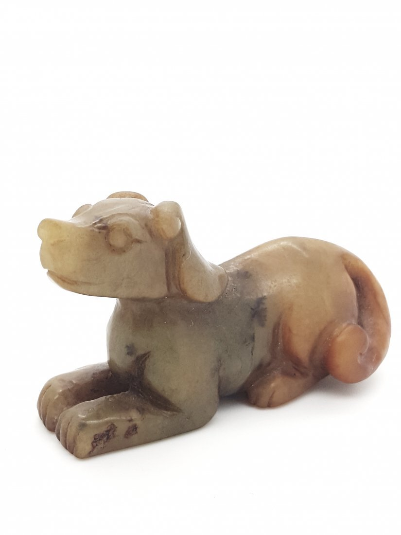 A jade carving of a seated dog- Song dynasty