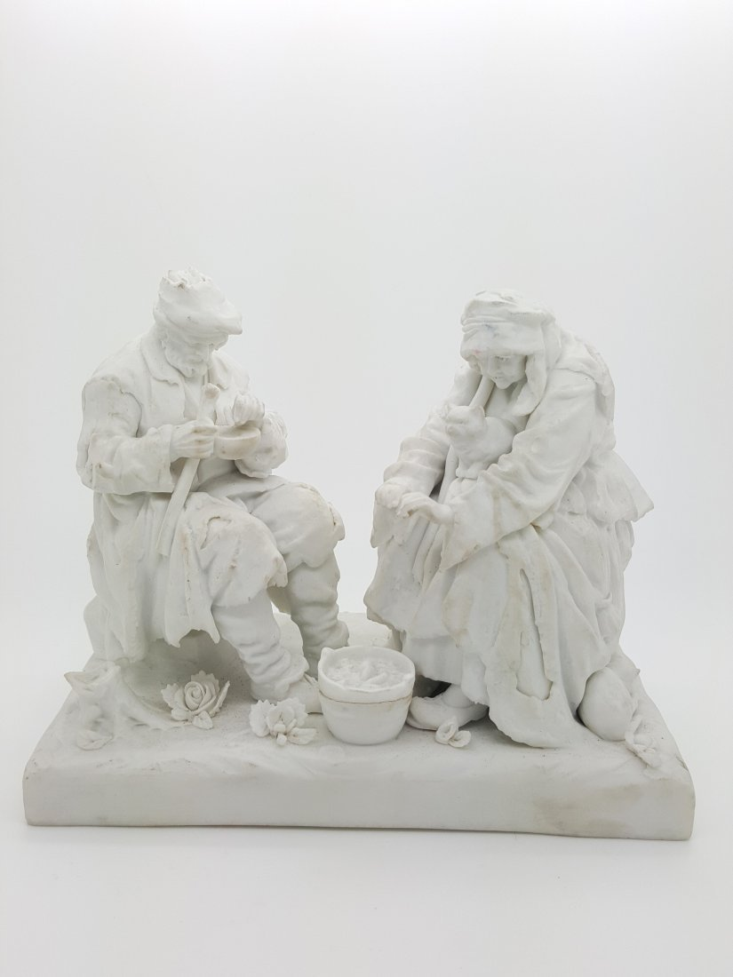 A 19th century white bisque porcelain figurine display