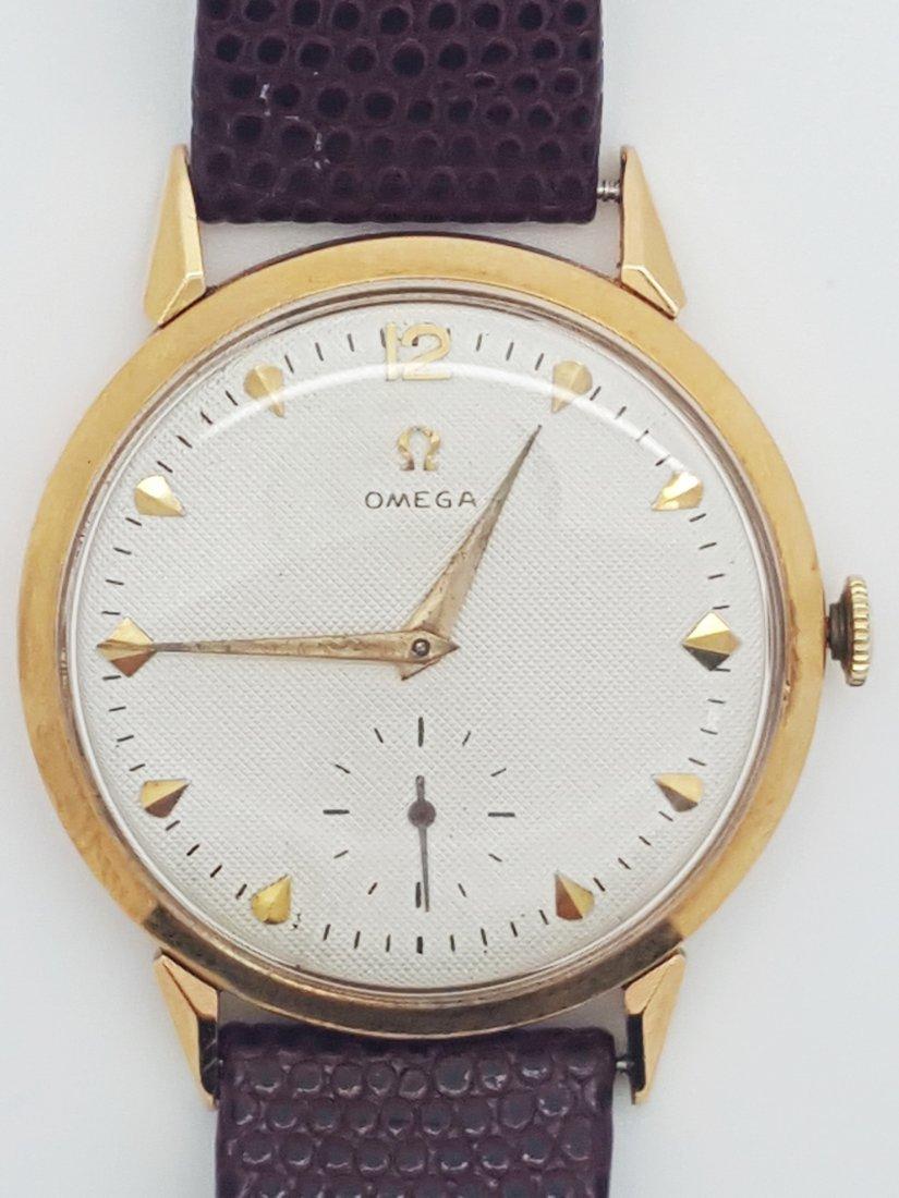 A vintage Omega 18k solid gold men's wrist watchÿmanual