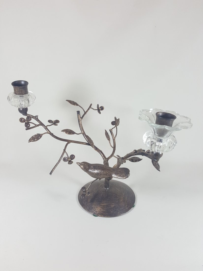 A branch and bird  candle holder