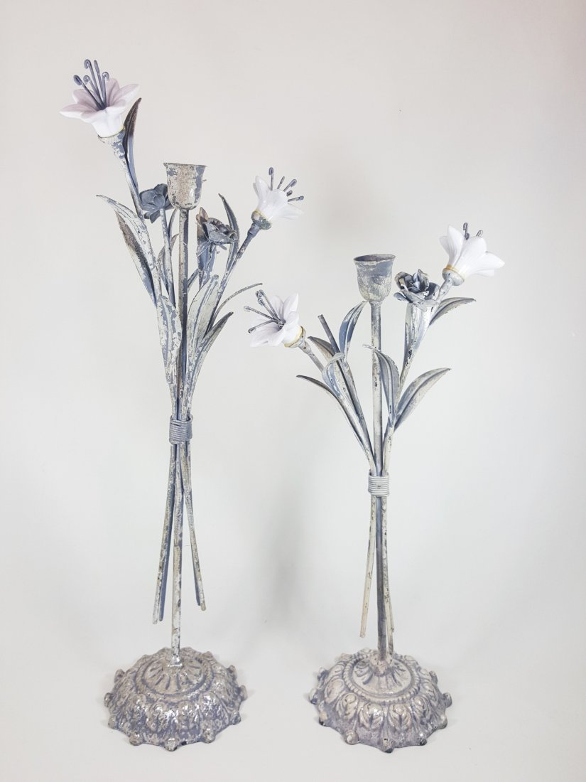 A pair of metal and porcelain candle holders