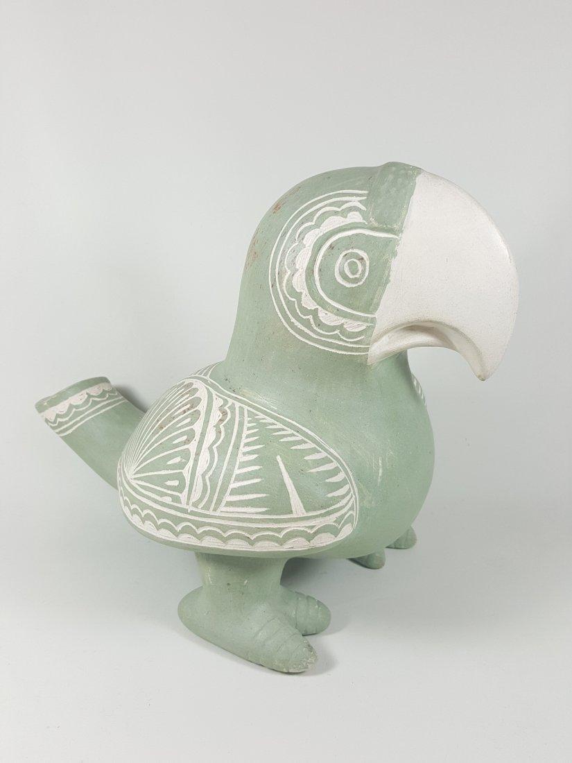 A hand made pottery bird