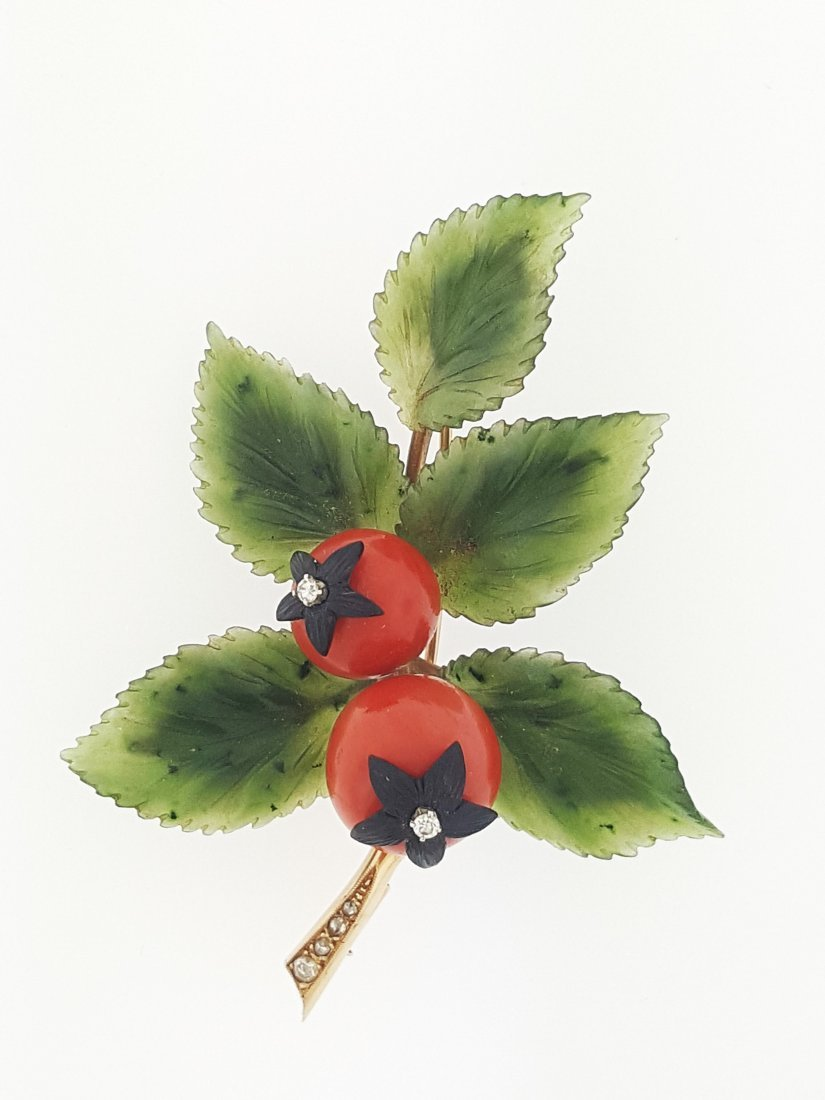 A gold brooch set in diamond nephrite jade red coral -