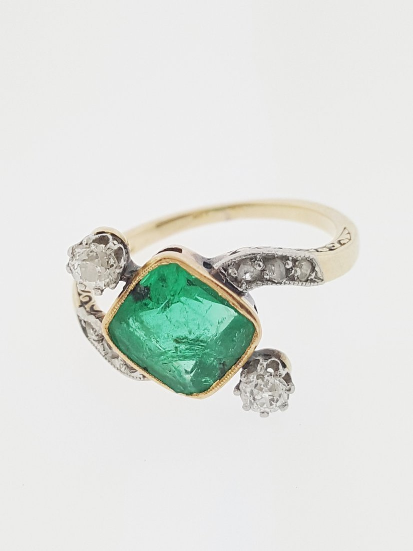A vintage 18k gold emerald and diamond ring