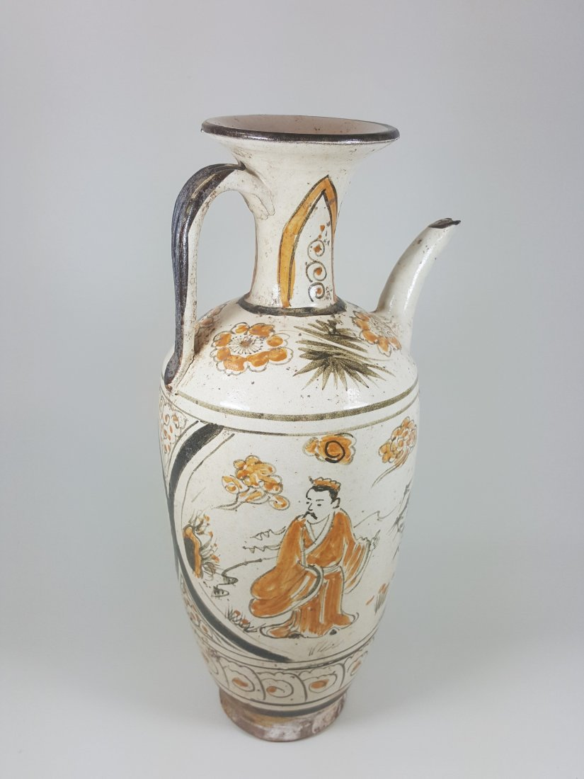 An archaic hand painted two-color Satsuma ewer