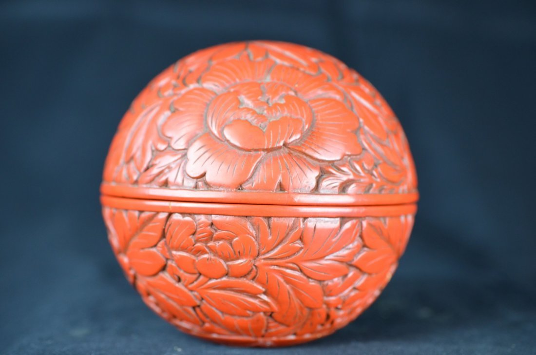 A Chinese Carved Red Laquer Round Shaped Box