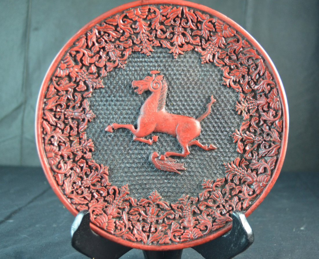 A Chinese Carved Cinnabar Plate with Running Horse
