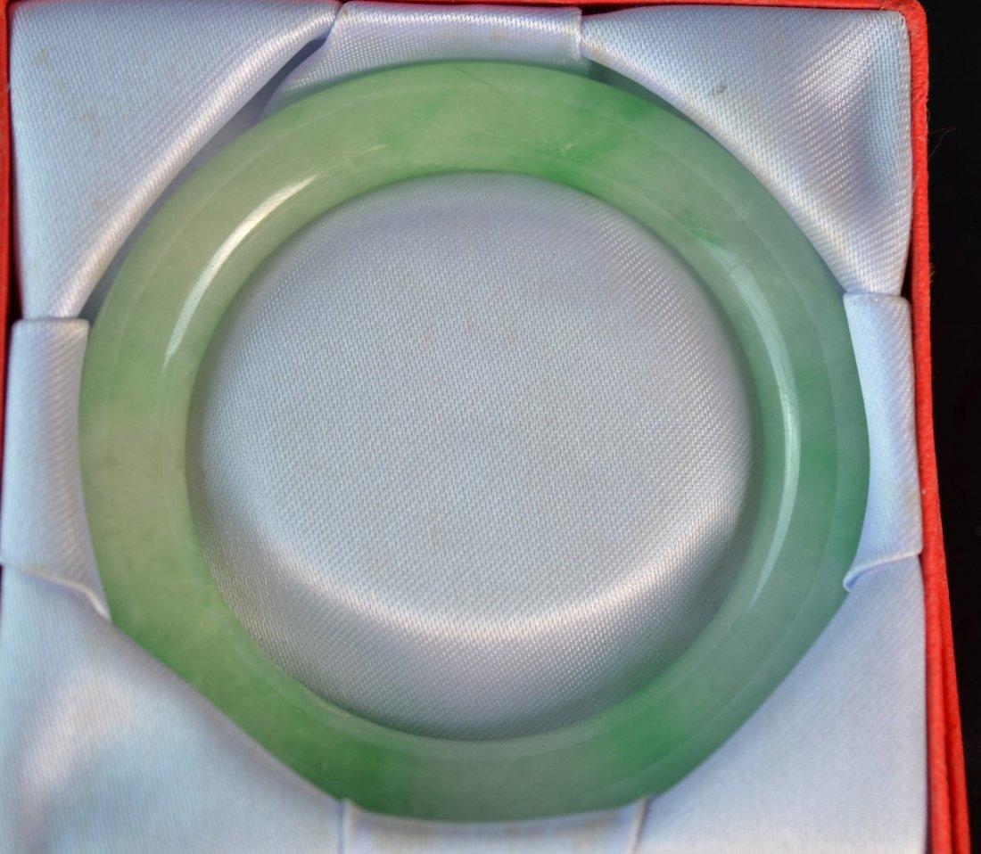 A Chinese Greenish Jade Bangle Bracelet