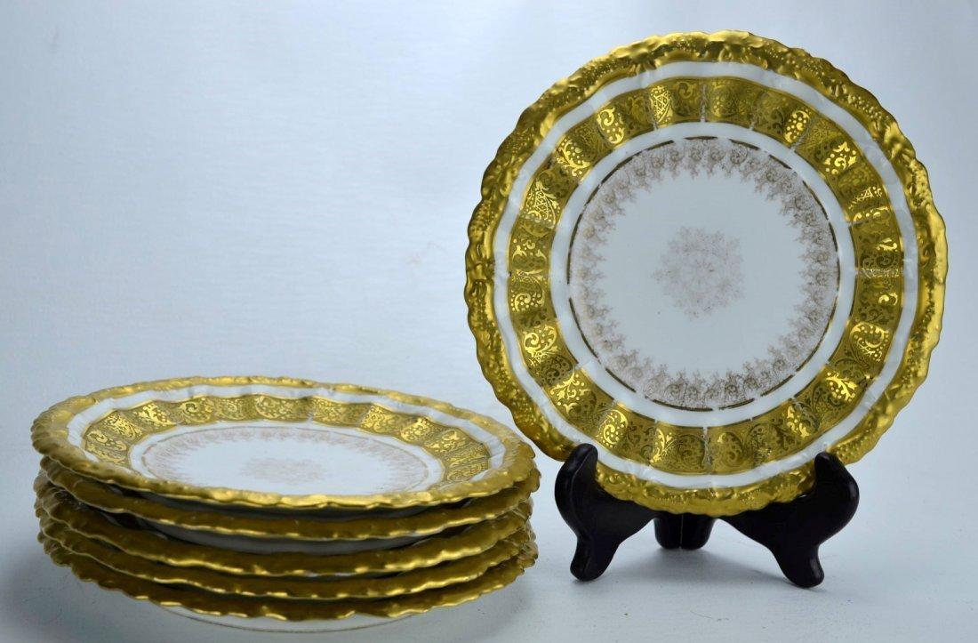 A. LANTERNIER Set of six porcelain plates