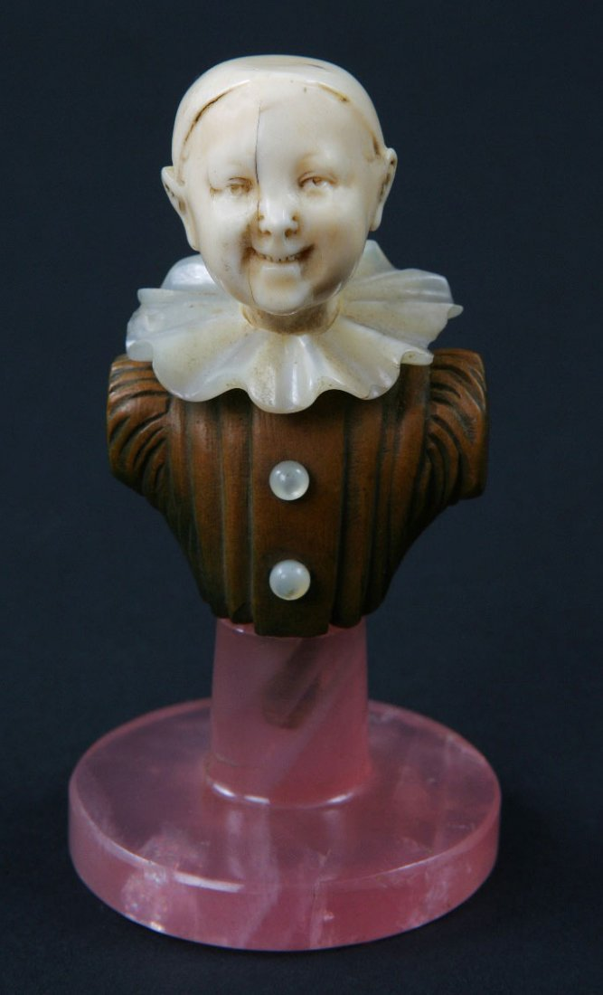 2: An Art Deco Ivory and Hardwood Bust of a Child.