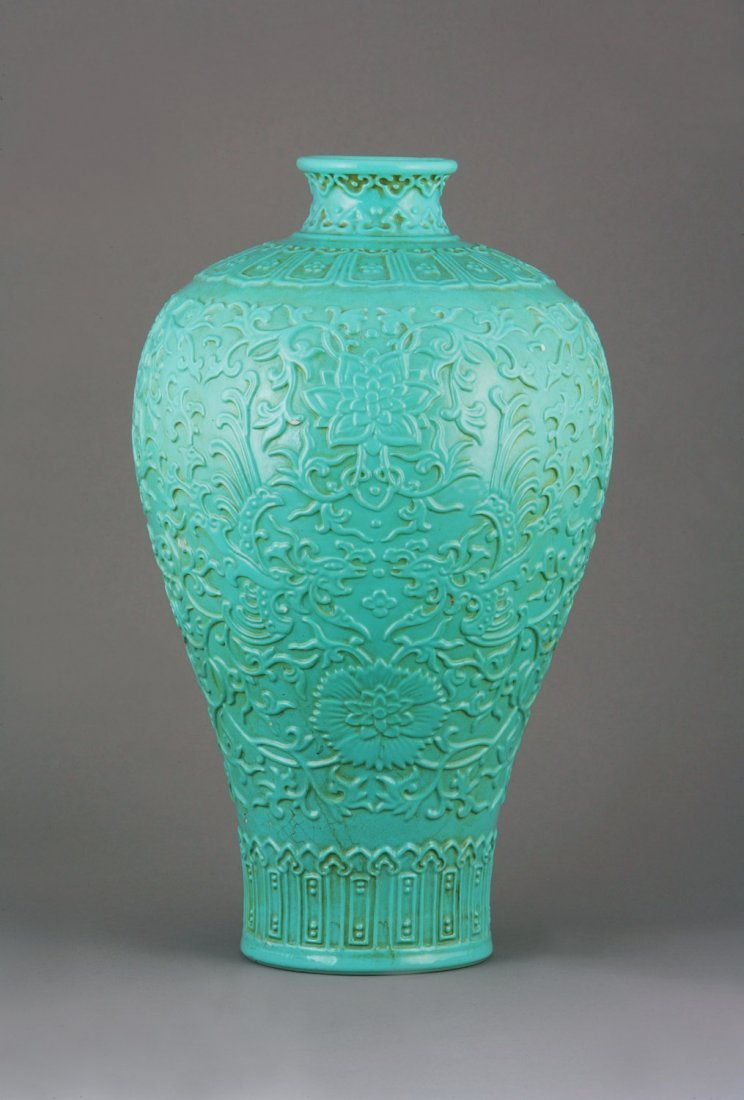 A Fine Chinese green Glaze Vase. With moulded decoratio