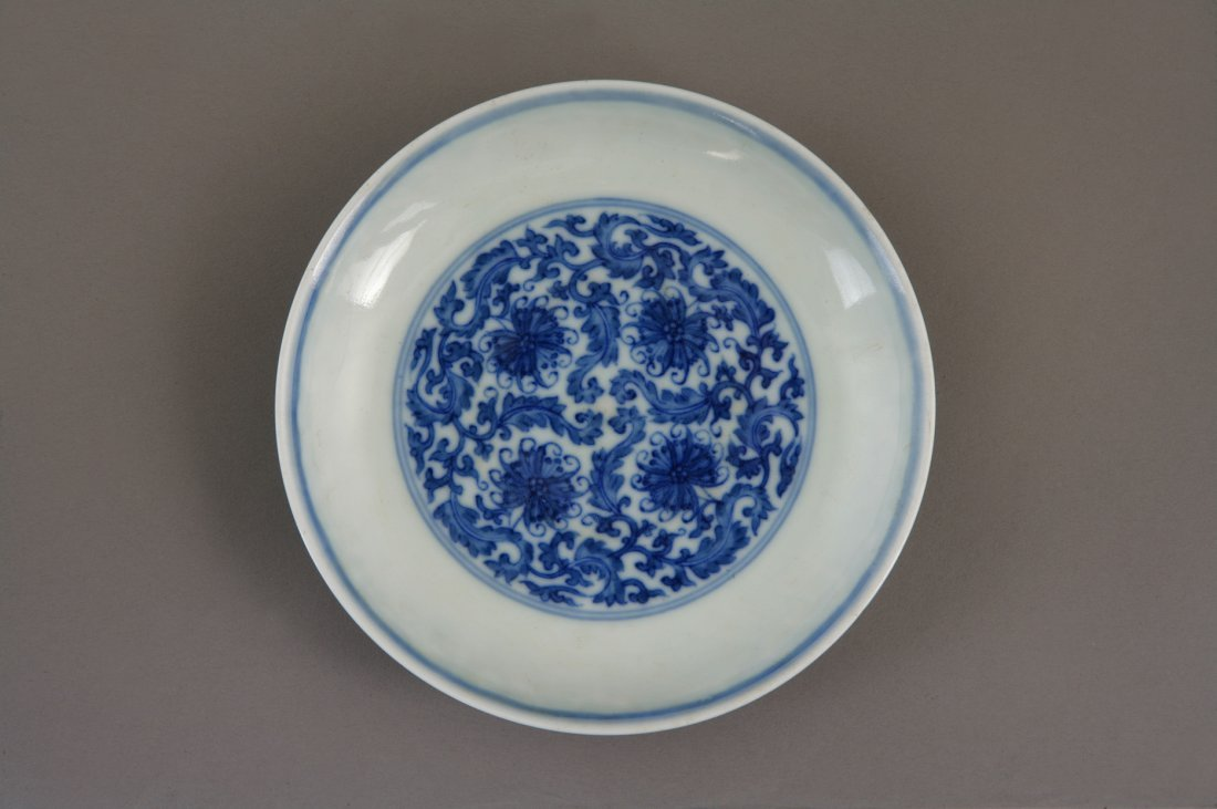 A Chinese Blue and White Saucer Dish. Decorated with sc