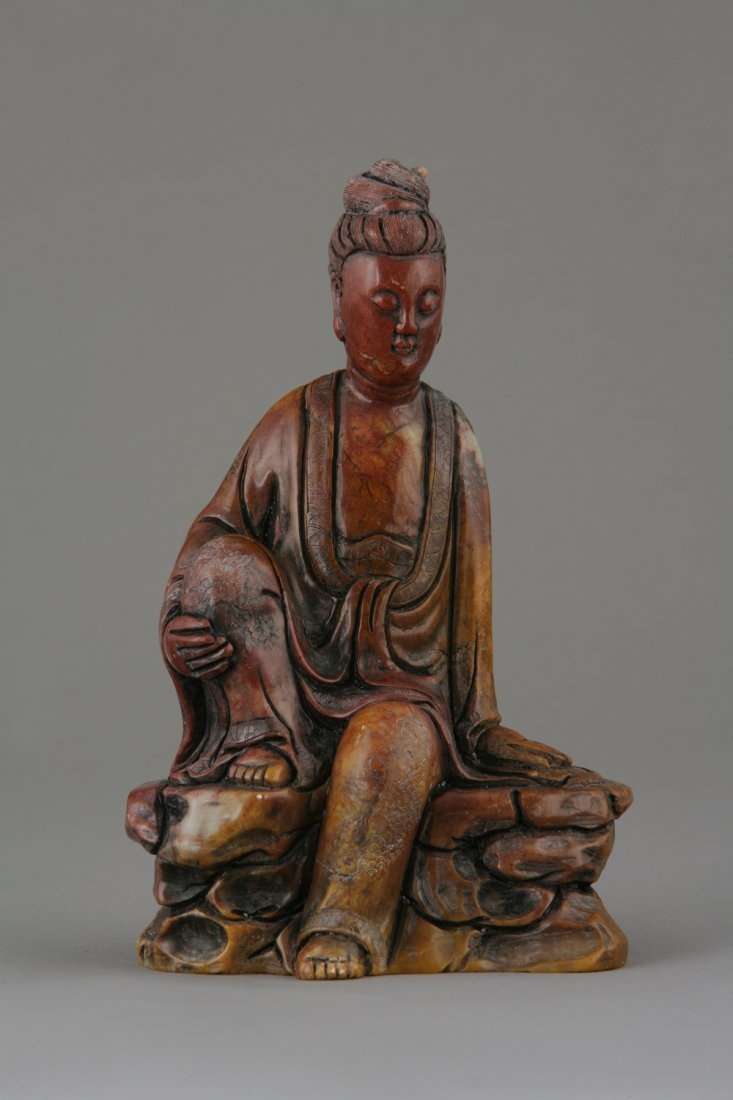 A chinese Soapstone Figure of a Deity. Shown seated on