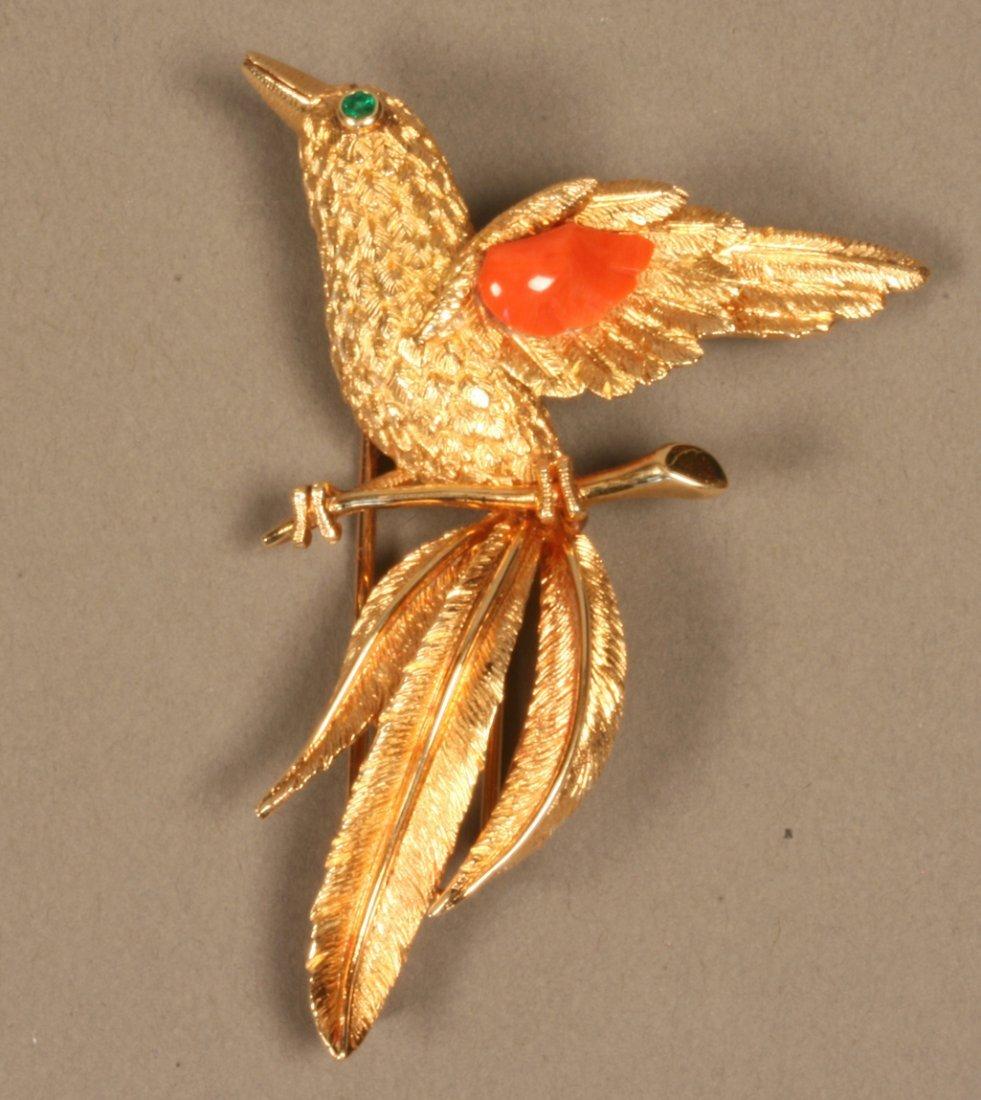 Cartier. An 18 carat Yellow Gold, Coral and Emerald Bir