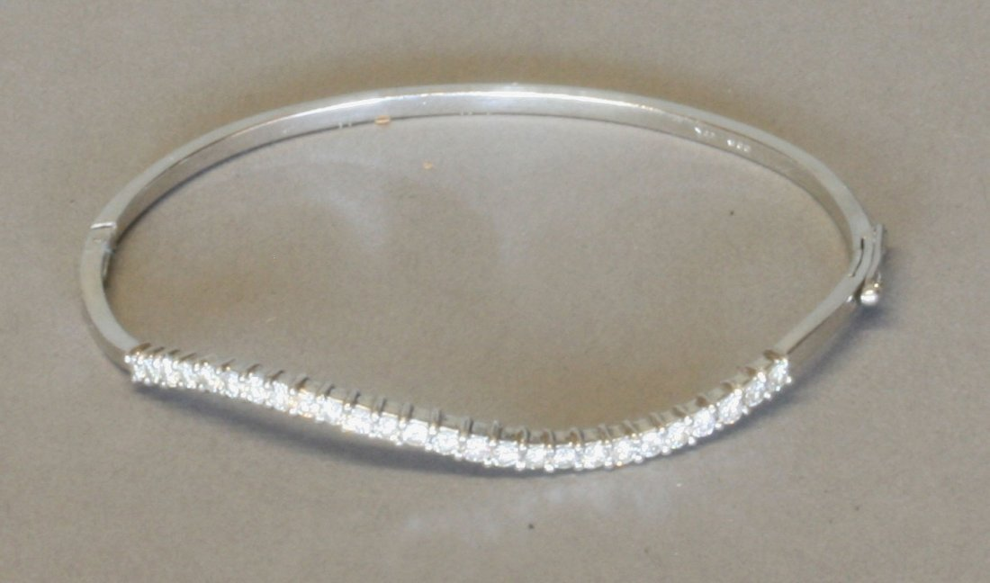 A Diamond Set Bangle. Modern. Set in high carat white