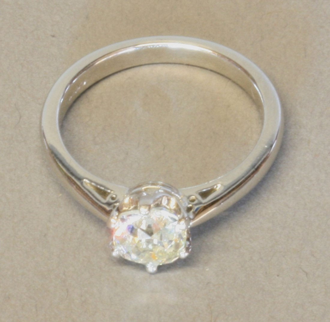 A Solitaire Diamond Ring. Set in Platinum (English
