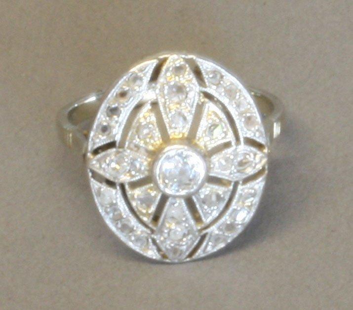 An Art Deco Diamond Dress Ring. Set in high carat white