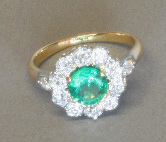 A Columbian emerald and Diamond set Lady's Dress Ring.