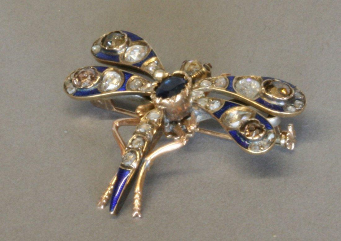 A Diamond and Blue Enamel Dragonfly Brooch. Circa 1900