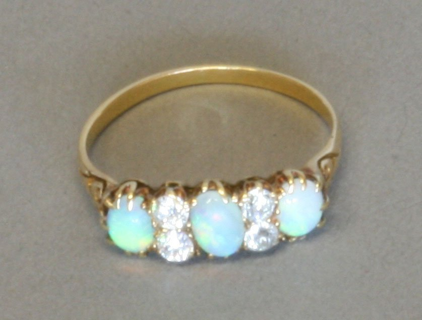 A Victorian Opal and Diamond Dress Ring. Late 19th