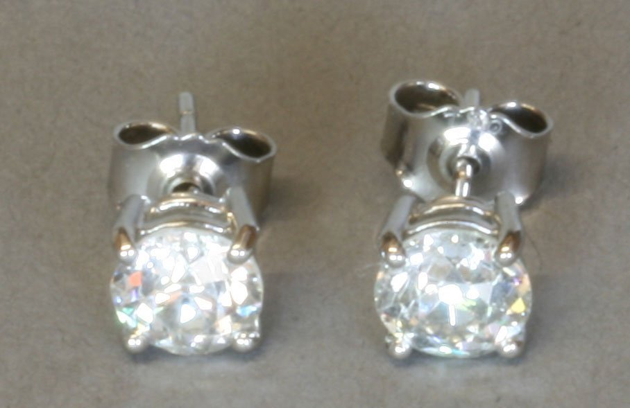A Pair of Diamond Posted Stud earrings. Each Diamond