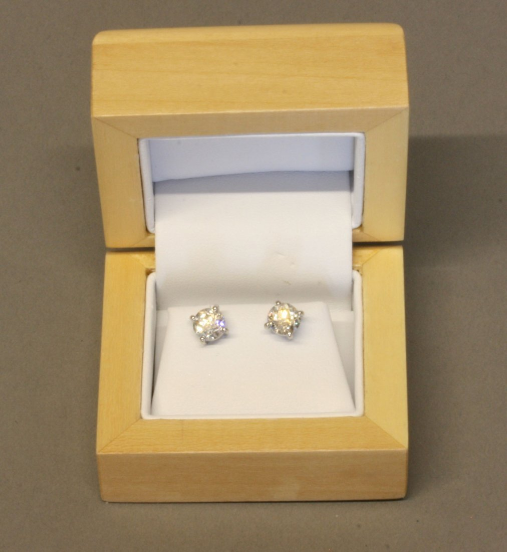 A Pair of Posted Diamond Stud earrings. 1.04 and 1.09
