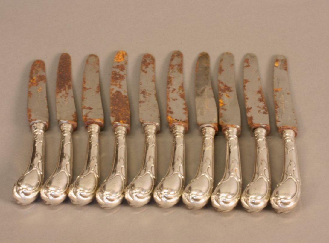 A Set of 10 Pistol Grip Silver Mounted Table Knives.