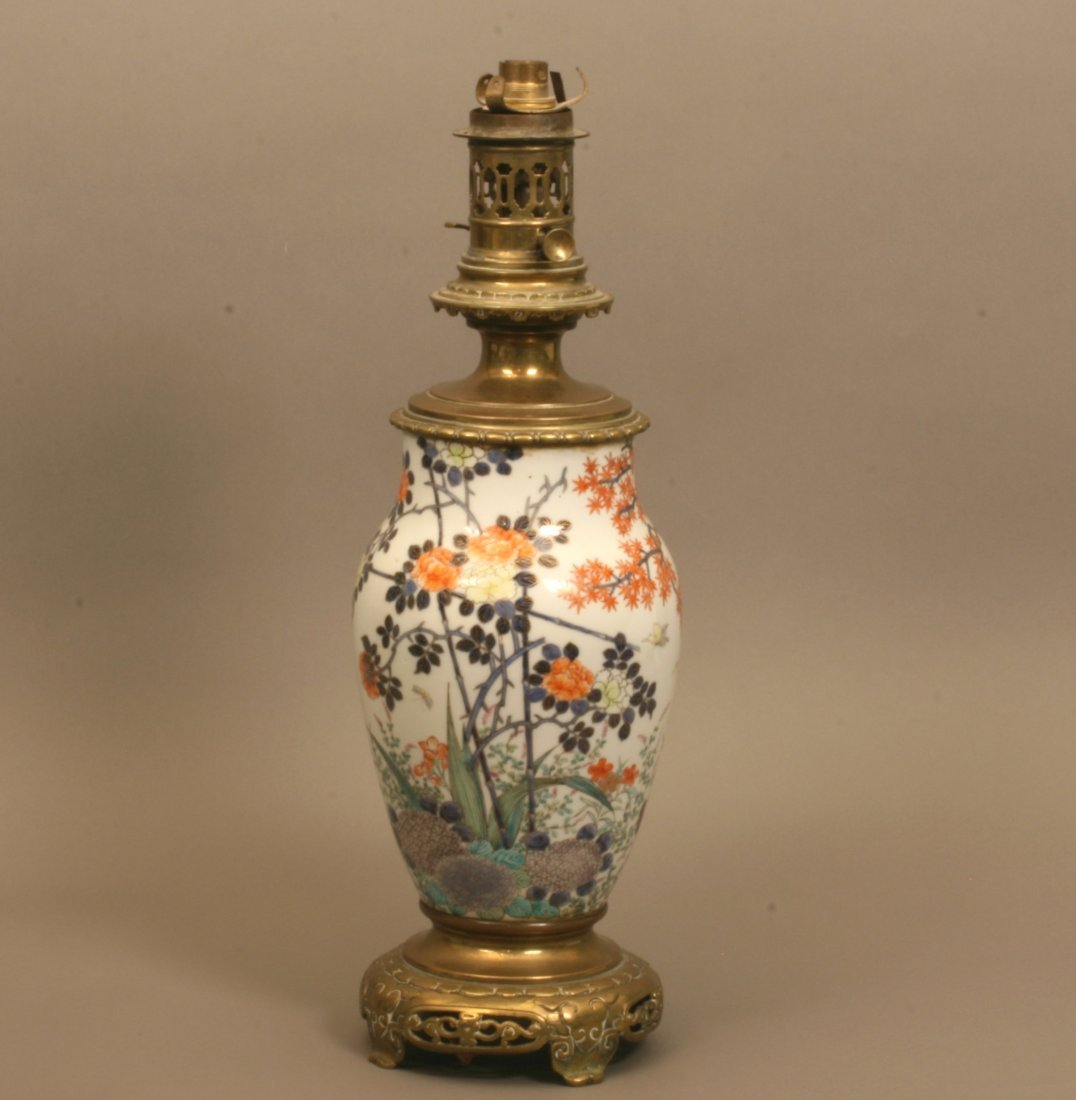 A Japanese Porcelain lamp with brass mounts