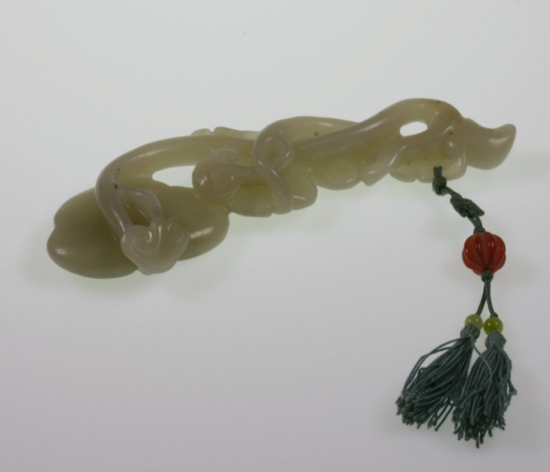 A Pale Green Jade Carving of a RUYI Scepter. 19th