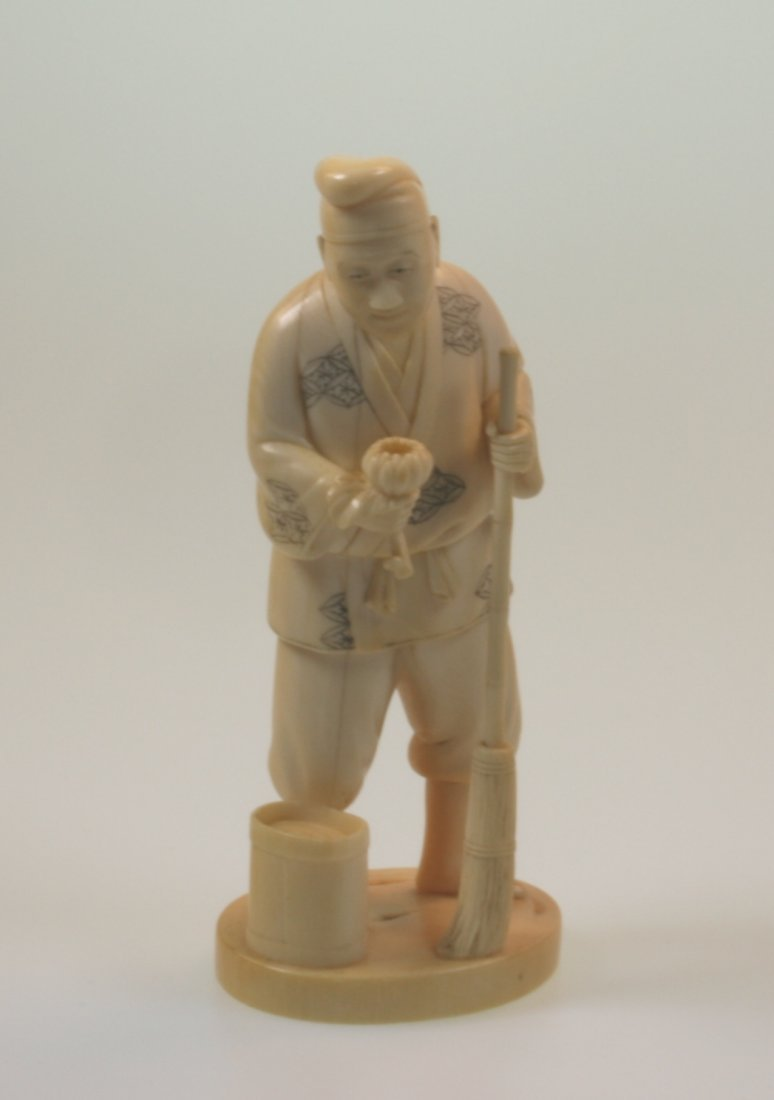 A Carved Ivory Figure of a Gardner. Signed. 19th