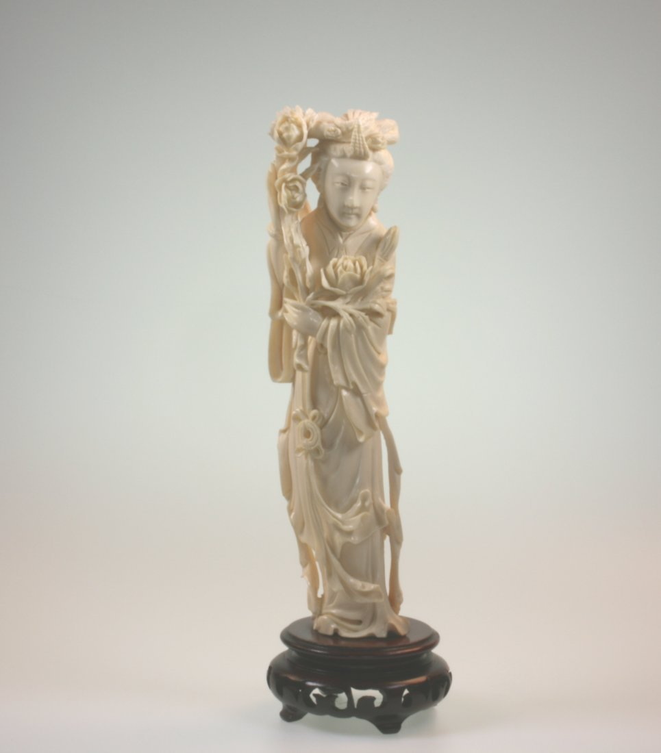 A Carved Ivory Figure of a Robed Lady. Wearing loose