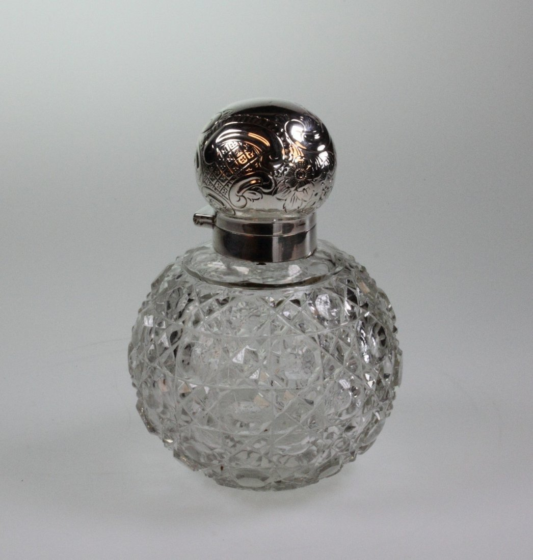 An Edwardian Silver Topped Scent Bottle