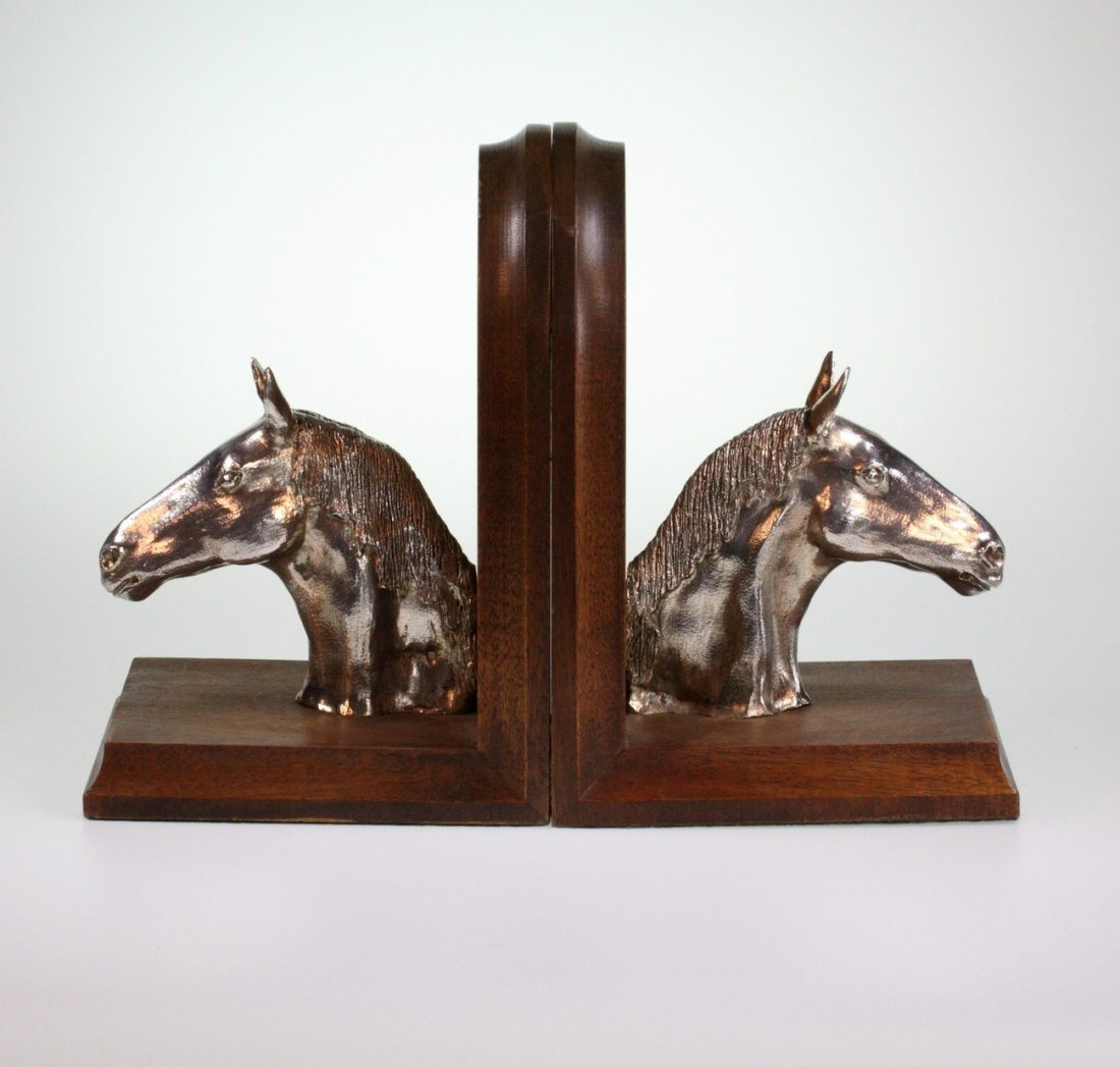 A Pair of Silver and Hardwood ''Horses Head'' Book Ends