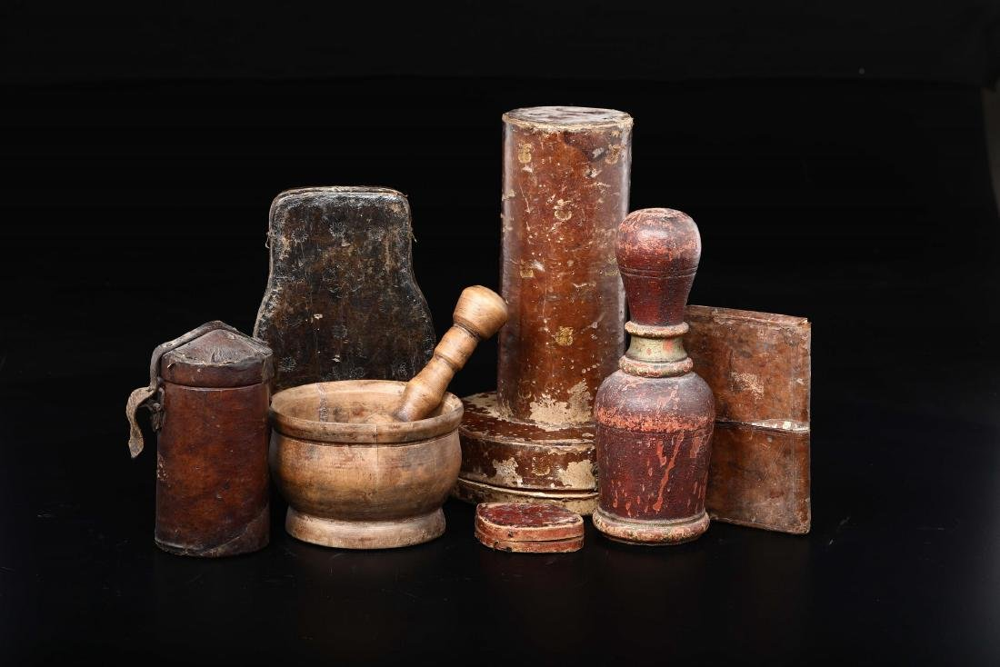 Group of objects and cases in polished wood, painted