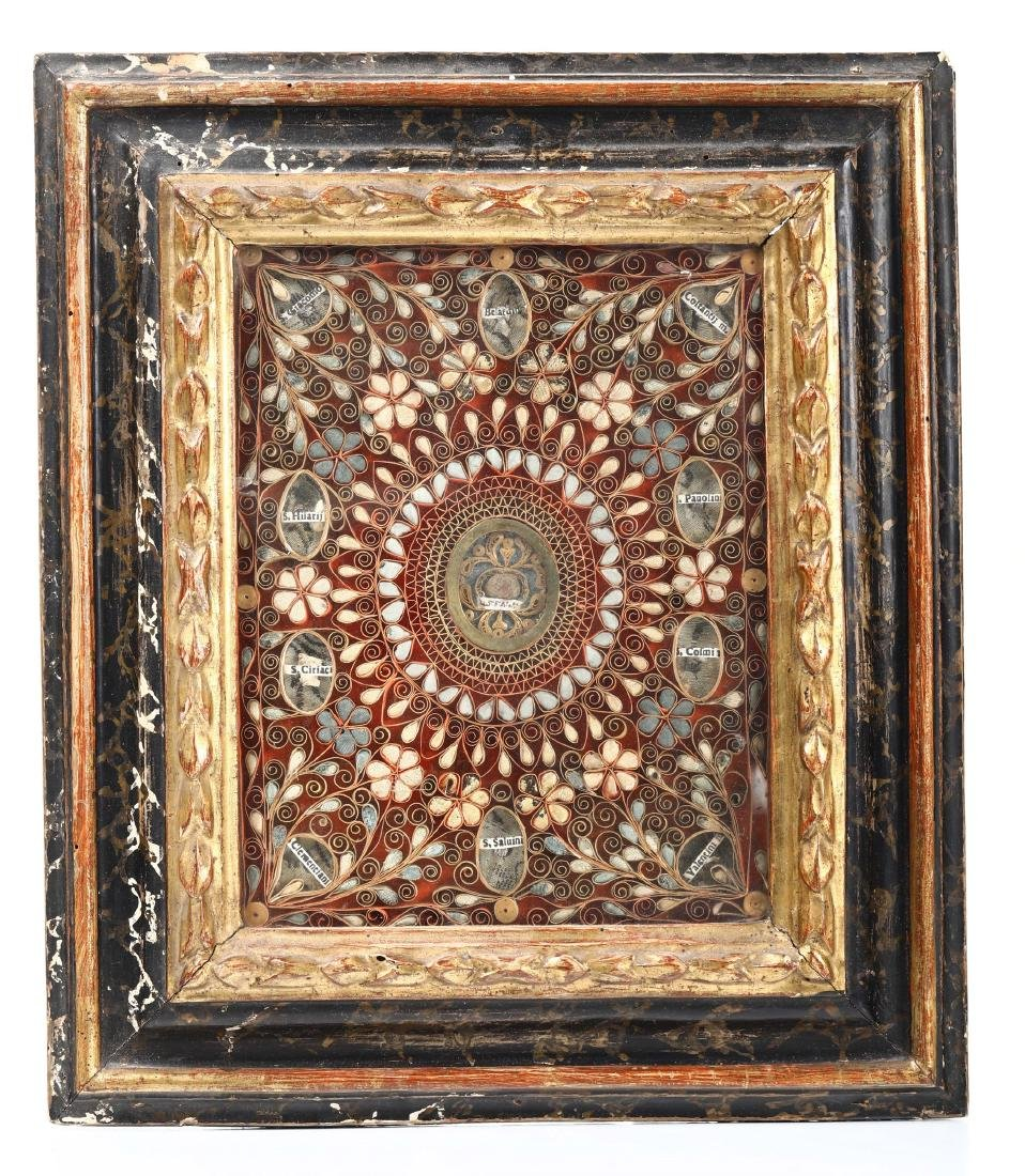 Papier-rolle reliquary within a wooden frame,