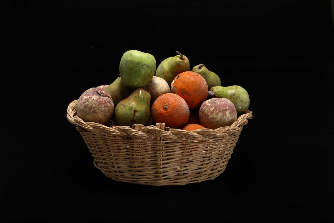 Woven wicker basket with colored wax fruit, Italy, 19th