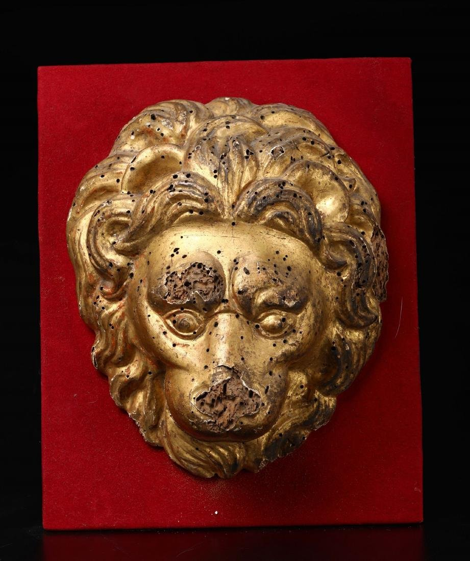 Lion's head in carved and gilded wood, Central Italy,