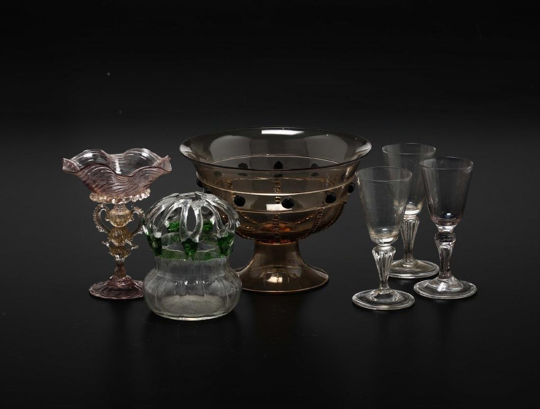 Group of glasses comprising  a bowl, a basket, a blown