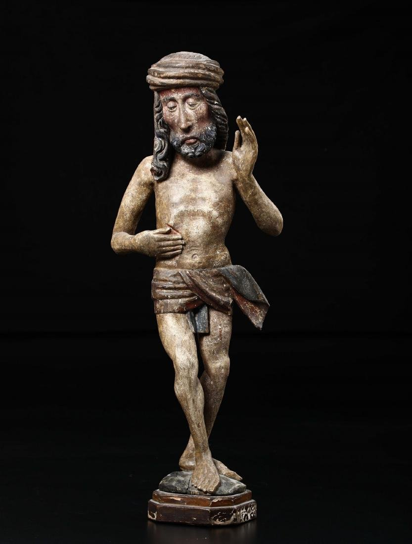 Polychrome wooden sculpture depicting Christ in the act