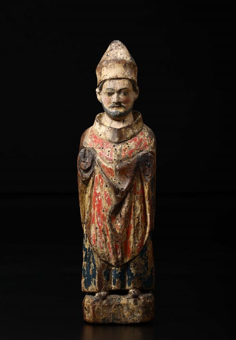 Bishop Saint in carved and painted wood. Central Italy,