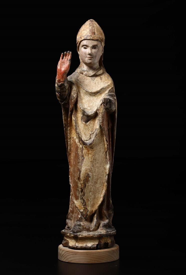 Bishop Saint carved in wood, with traces of polychromy.