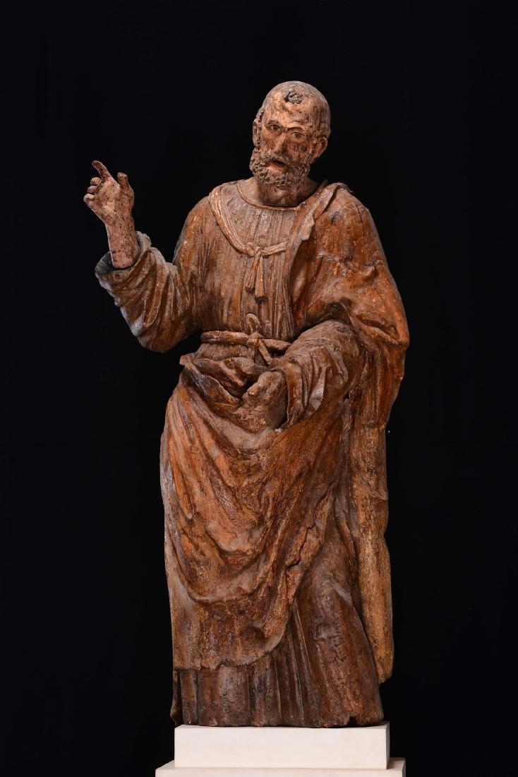 A polychrome and gilt wooden Saint, Lombard sculptor.