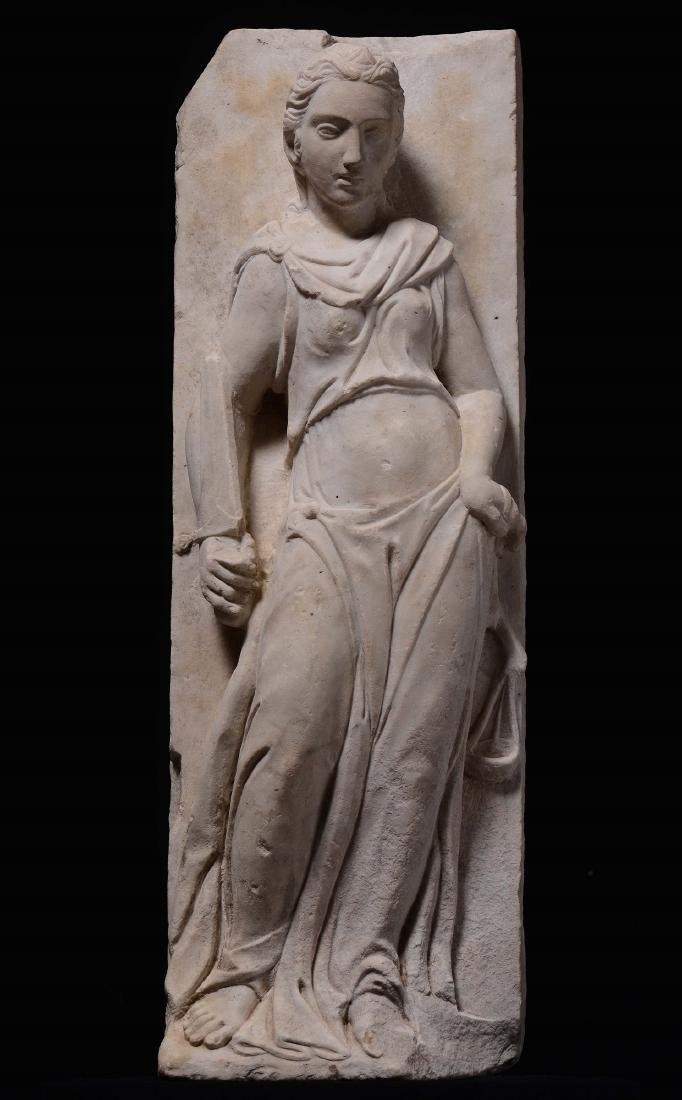Marble relief depicting an Allegory of Justice.