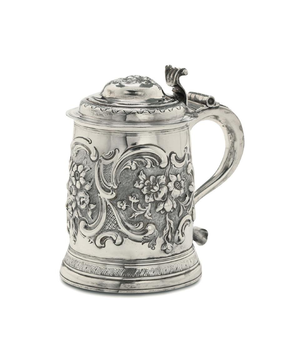 A tankard in silver, molten, embossed and chiselled,