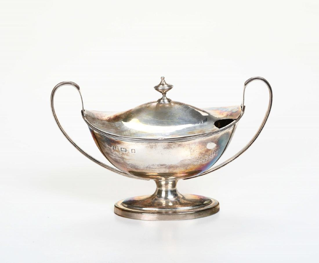 A sauce boat in molten, embossed and engraved silver,