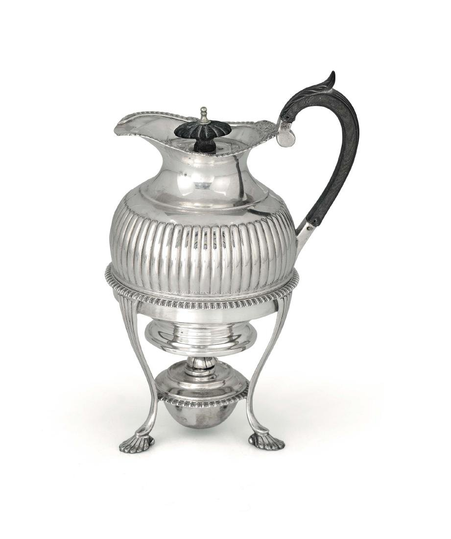 A teapot with burner in Sterling silver, London (marks