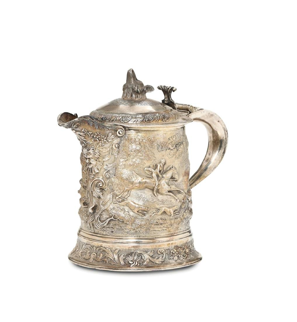 A large Tankard in molten, embossed, chiselled and